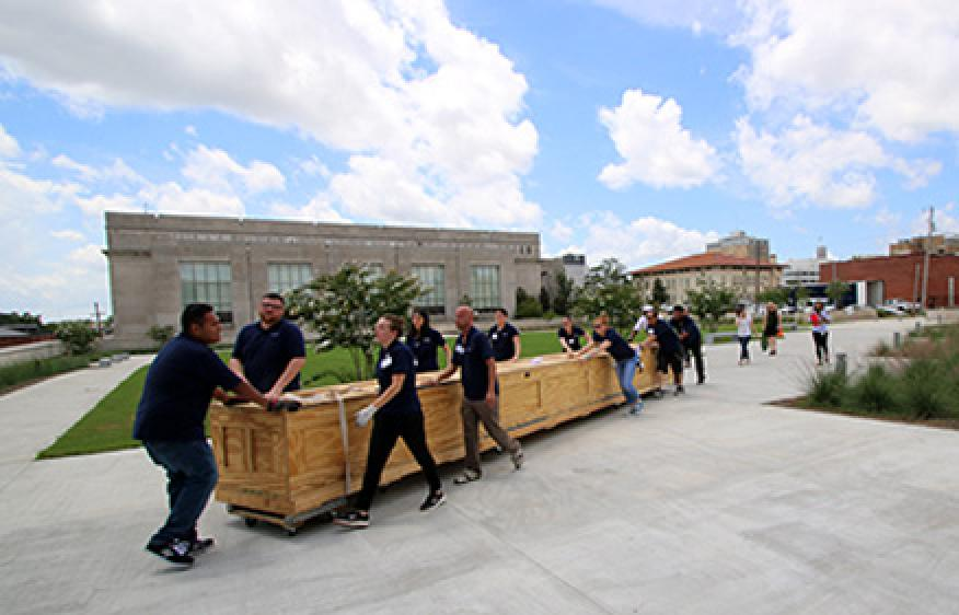 A twenty-five-foot-long dugout became the first of 17,000 artifacts to enter the Museum of Mississippi History and the Mississippi Civil Rights Museum last week.
